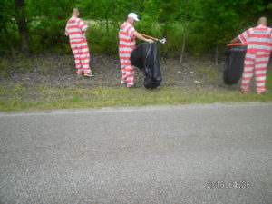 Inmates Cleaning Litter